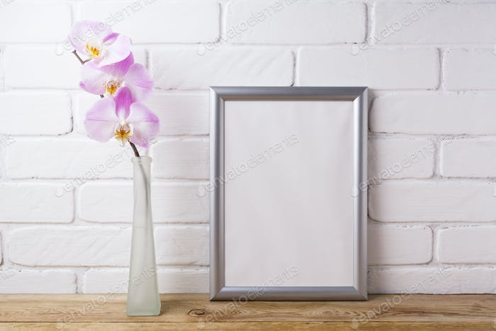 Silver frame mockup with tender pink orchid