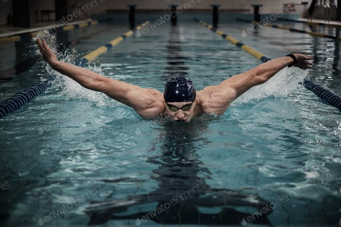 Man swims using breaststroke technique