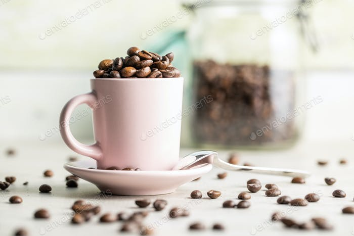 Roasted coffee beans in cup