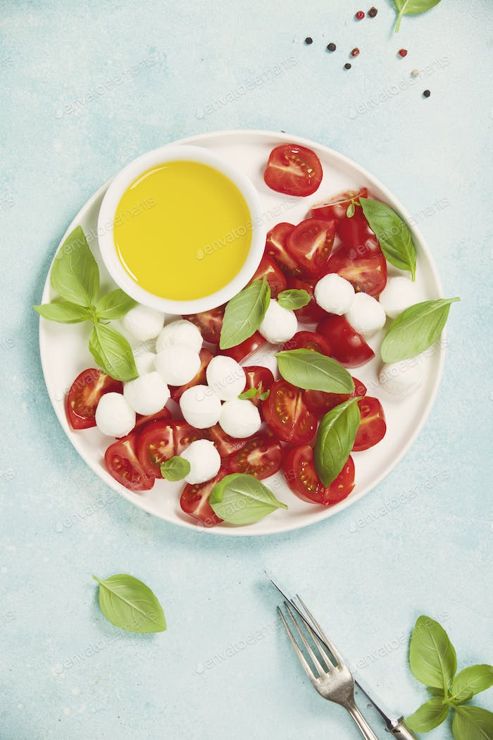 Caprese salad with basil and mozzarella balls