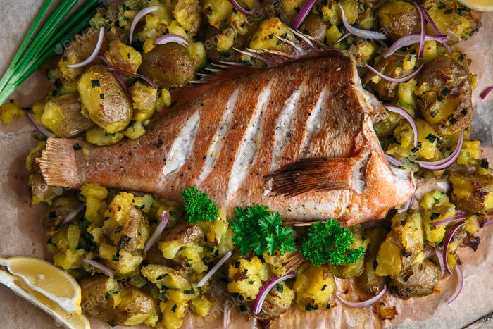 Close view of red grouper baked with potatoes, top view
