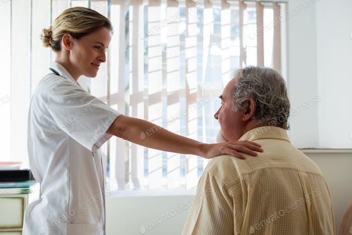 Doctor talking to senior man in nursing home