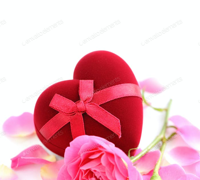 Heart-shaped Gift Box with pink rose on white background