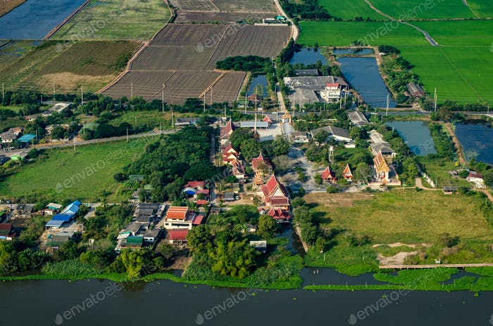 Farm land, rice fields and Buddhist temple aerial