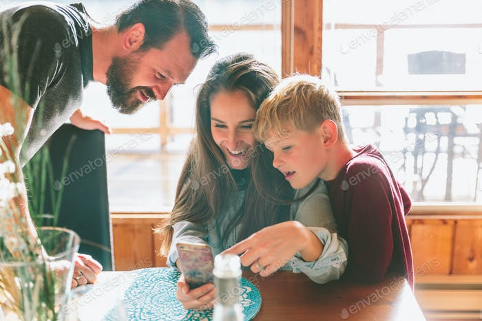 Family Looking at a Smartphone