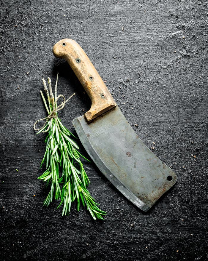 Bunch of fresh rosemary with a big knife.