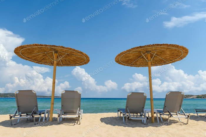 Beach chairs with umbrella with blue sky