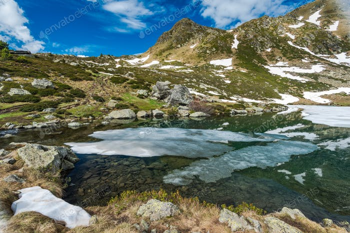 Remaining ice on alpine lake in Pyrenees,Andorra