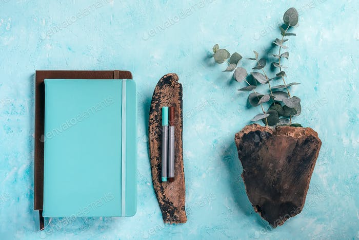 Top view of blue and brown notebooks