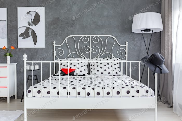Grey bedroom with large bed