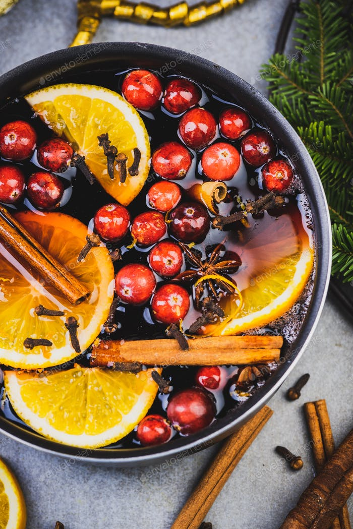 Mulled Wine with Traditional Ingredients on Festive Christmas Table