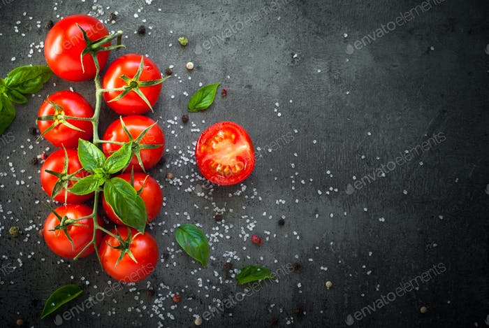 Fresh cherry tomatoes on a black