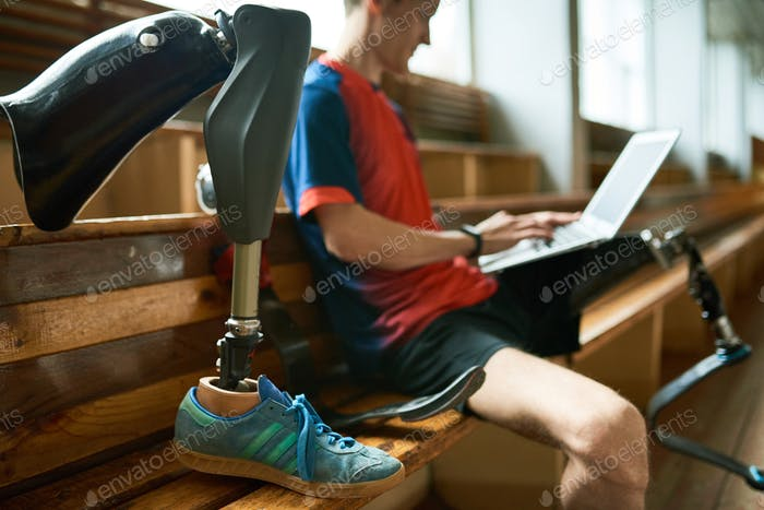 Disabled Sportsman Using Laptop