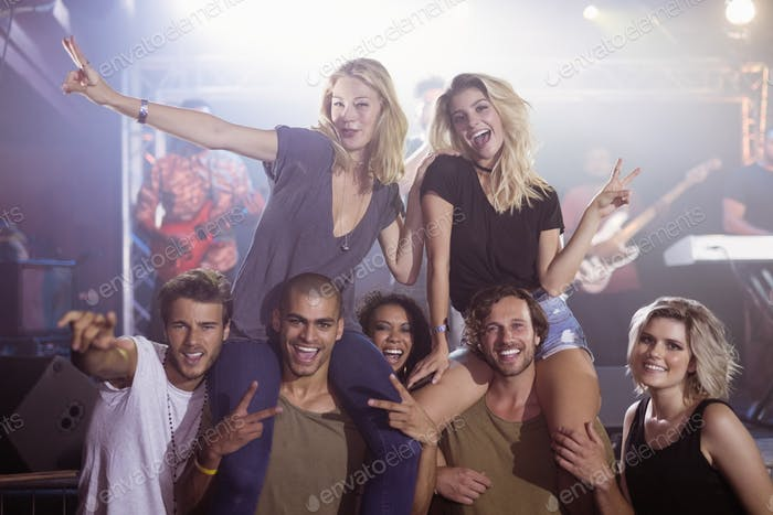 Portrait of cheerful young friends at nightclub
