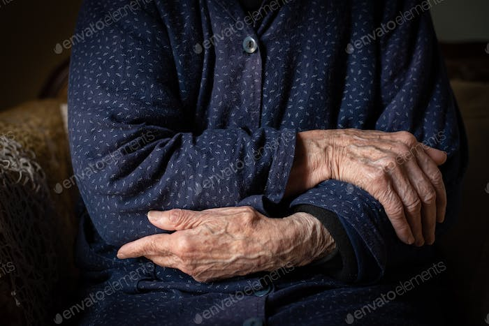 Elder grandmother woman crossing her wrinkled beautiful hands. Aging human process