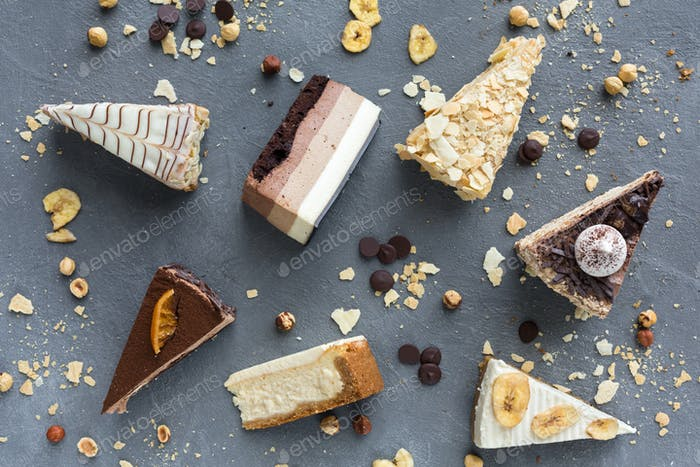 Assortment of pieces of cake, copy space