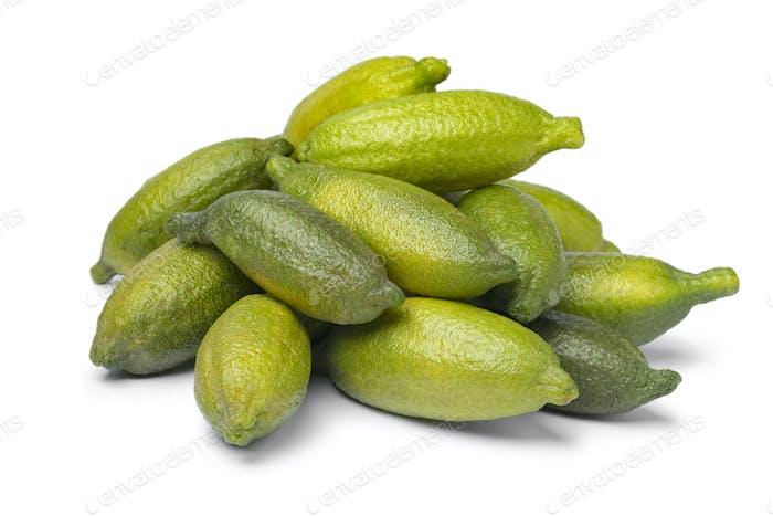 Heap of fresh raw green finger limes