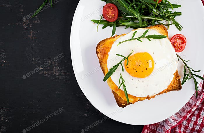 Breakfast. French cuisine. Croque madame sandwich close up on the table. Top view, overhead
