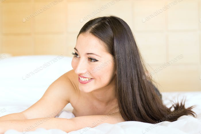 Beautiful young woman lying