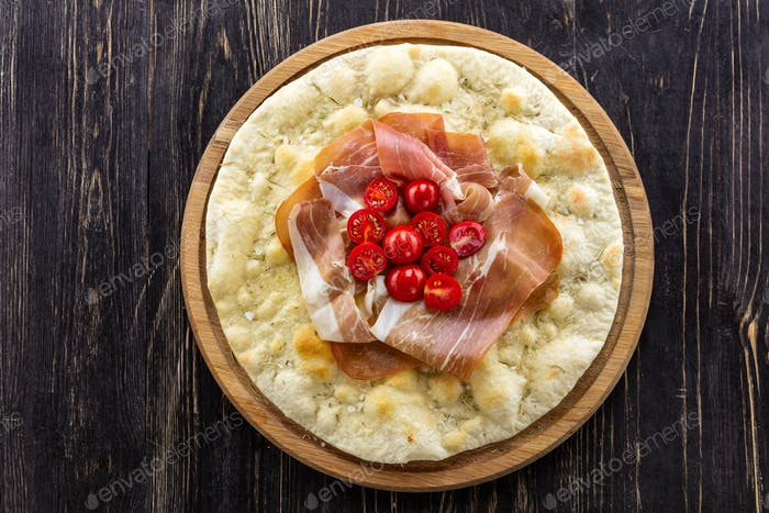 Focaccia with prosciutto and cherry tomatoes