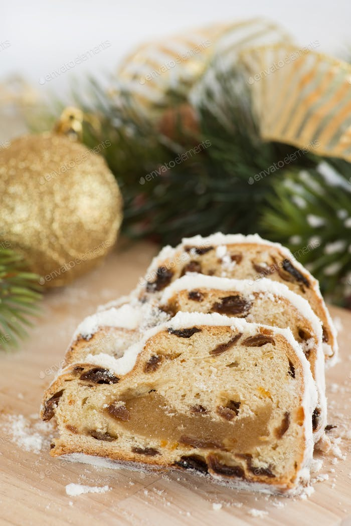 Stollen with marzipan for Christmas with festive decorations