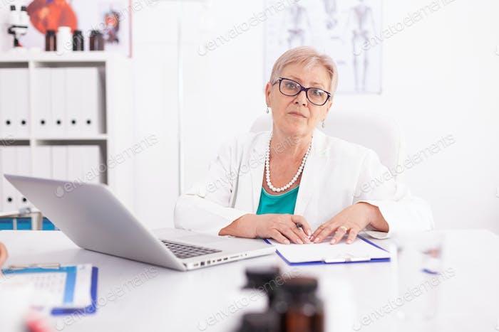 Mature female doctor wearing lab coat