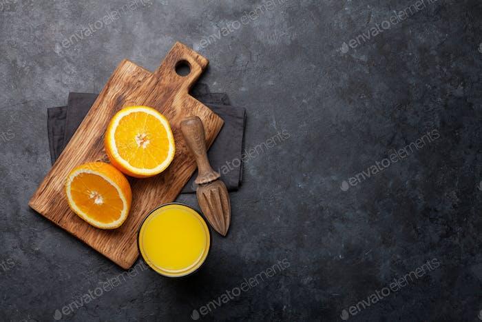 Fresh orange juice and oranges