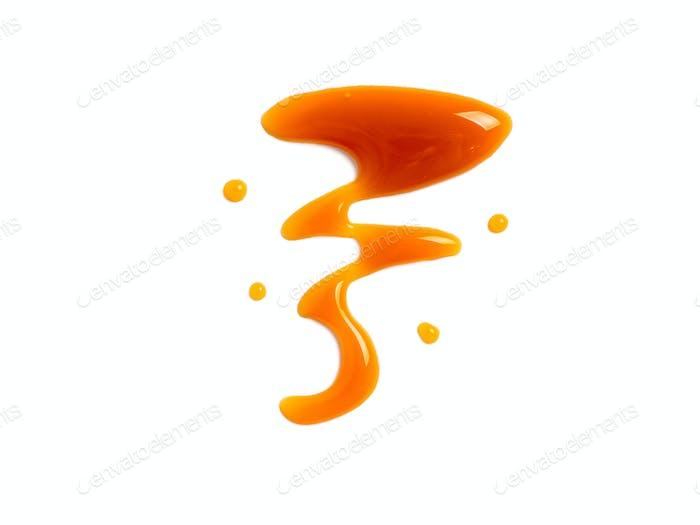 sweet caramel sauce isolated on white