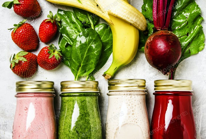 Multicolored smoothies and juices from vegetables, fruits and berries