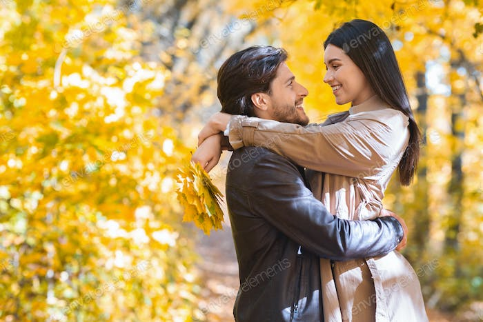 Romantic couple enjoying weekend at autumn forest