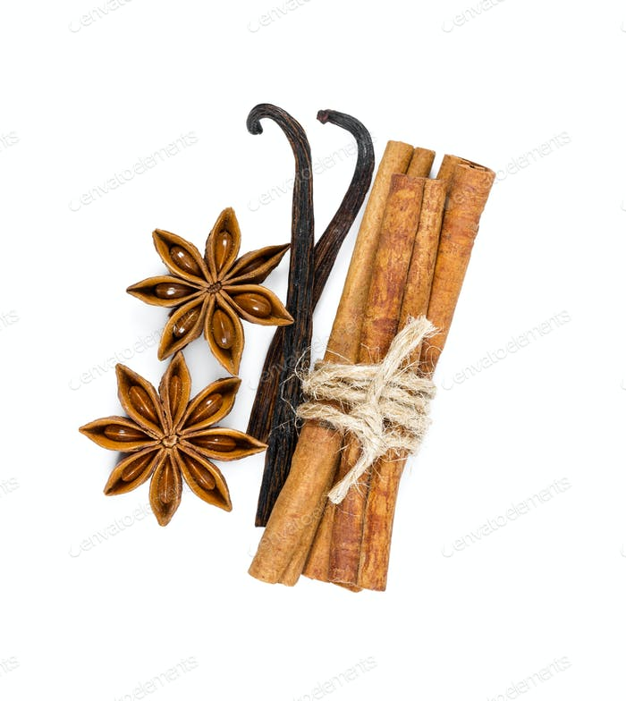 Cinnamon, star anise and vanilla isolated on white