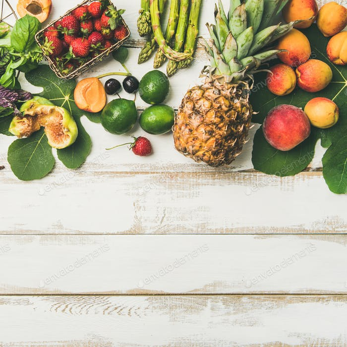 Seasonal fruit, vegetables and greens over wooden background, square crop