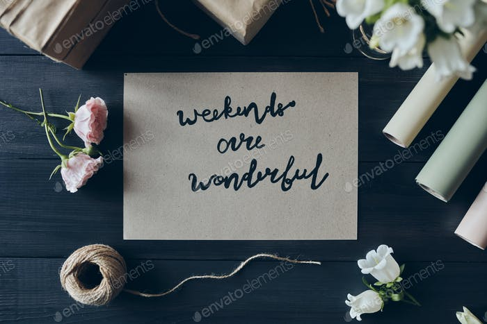 High angle view of romantic card with Weekend Are Wonderful text