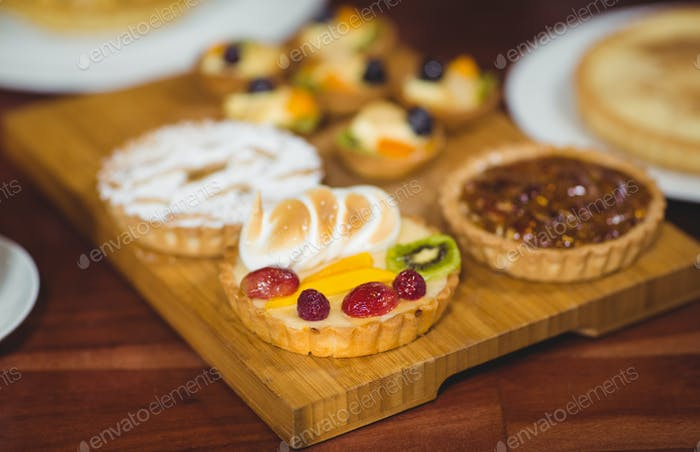 Close up wooden tray of tasty pastries at the bakery