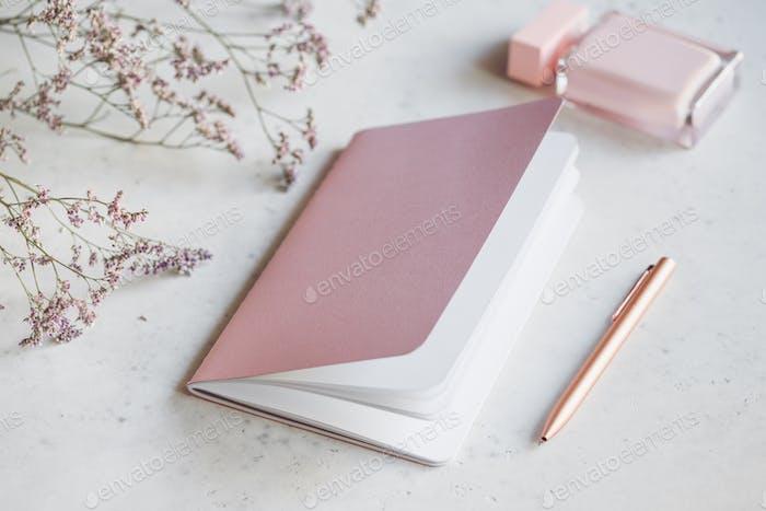 Pink empty paper notebook