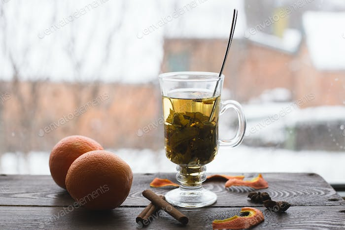 A cup of tea with oranges and cinnamon