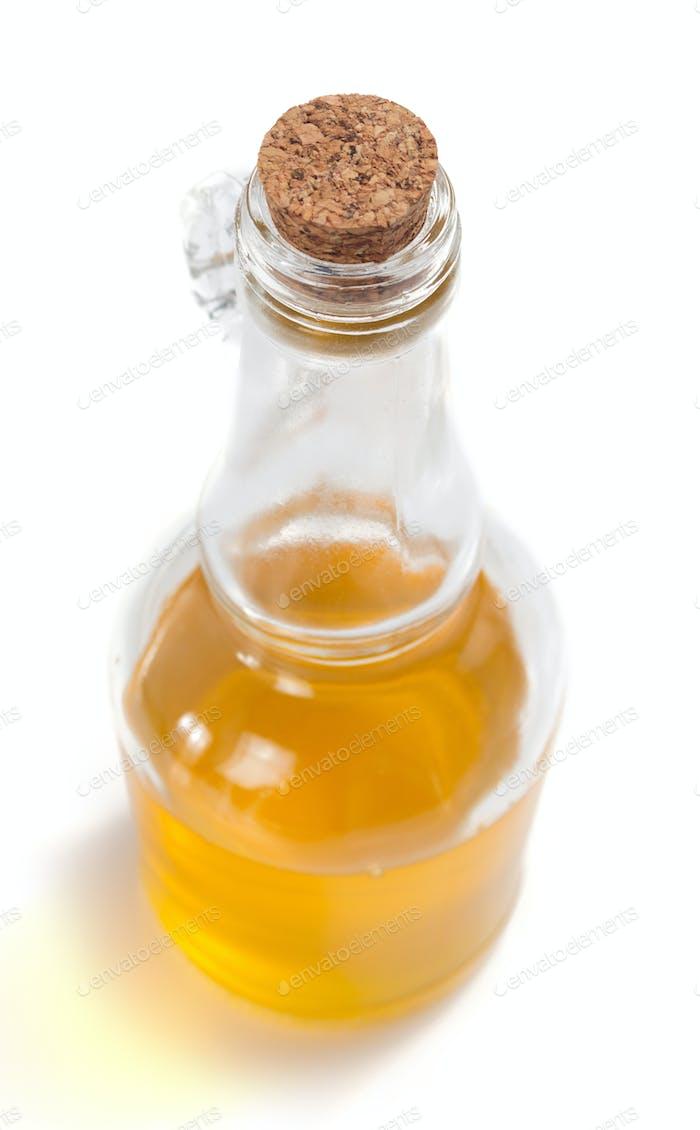 food oil in bottle on white