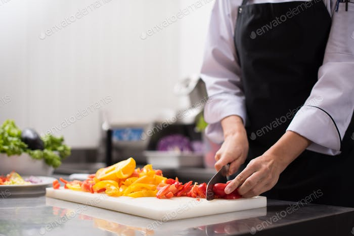 Chef cutting fresh and delicious vegetables