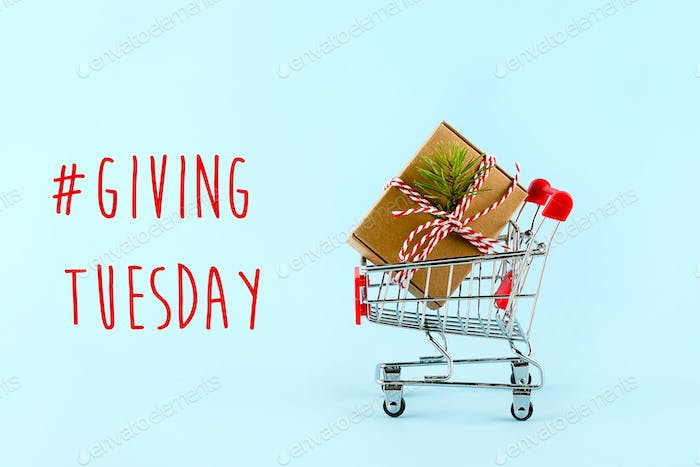 Giving tuesday holiday. Trolley with gift box. Charity, donations concept.