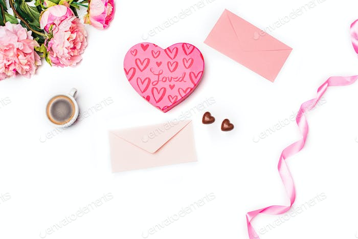 The gift box with hearts on white background