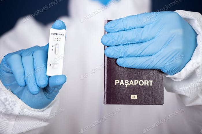 Doctor with laboratory COVID-19 negative test and passport.