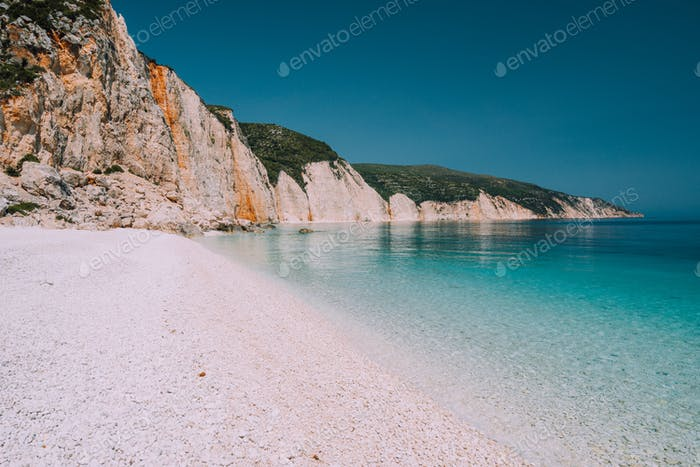 Holiday vacation scene. Fteri beach on Kefalonia Island, Greece. Most beautiful pebble beach with