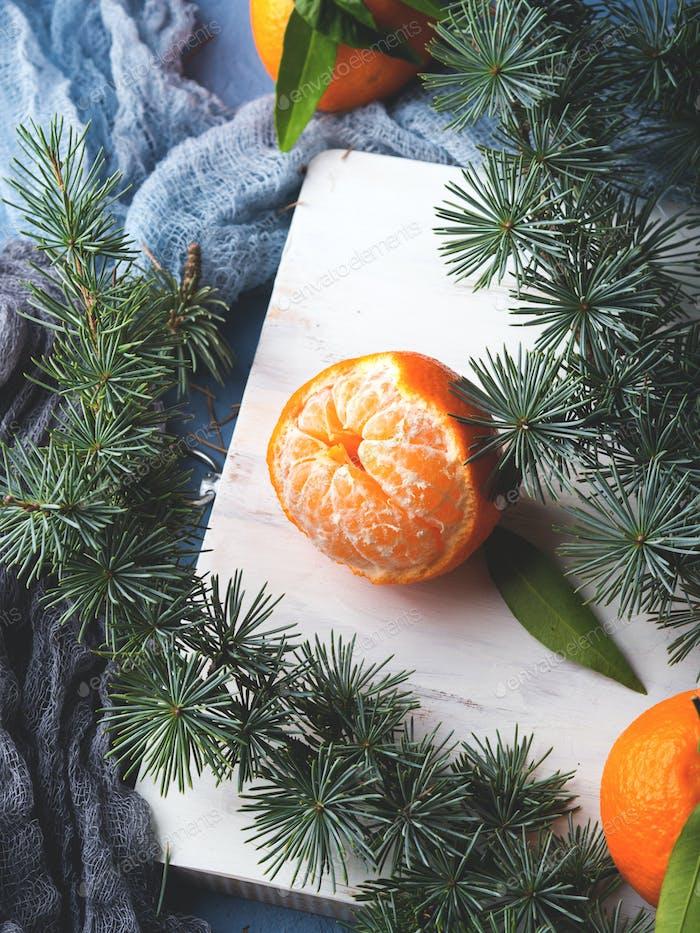Fresh tangerines on white rustic board
