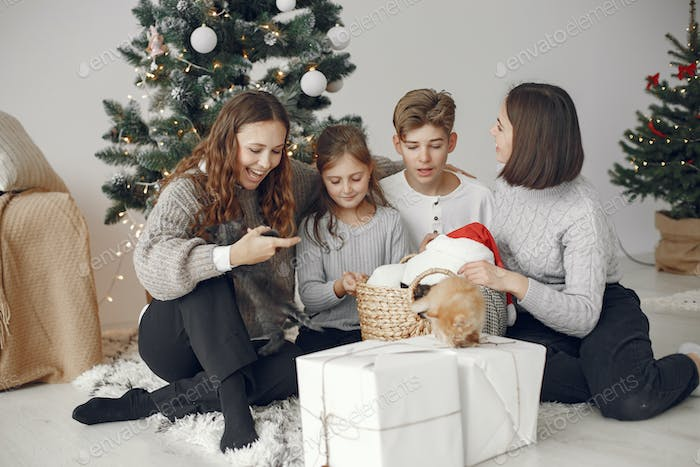 Family at home with little cats