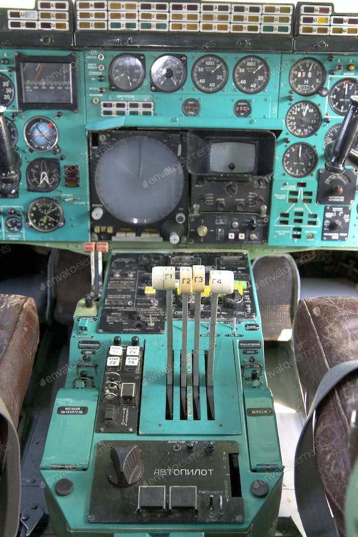 Airplane Cockpit thrust levers with hand on top for takeoff, Tu-