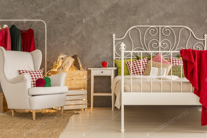 Room with bed and armchair