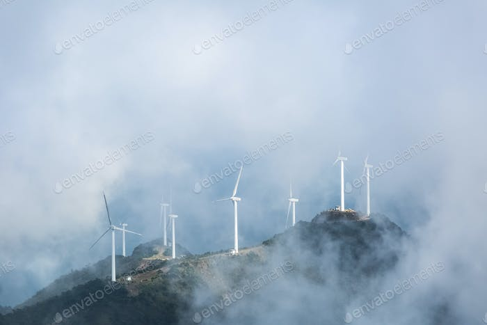 wind farms in the misty clouds