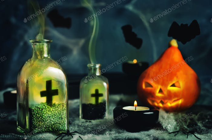 Halloween horror background with a spider's web, pumpkin; candle