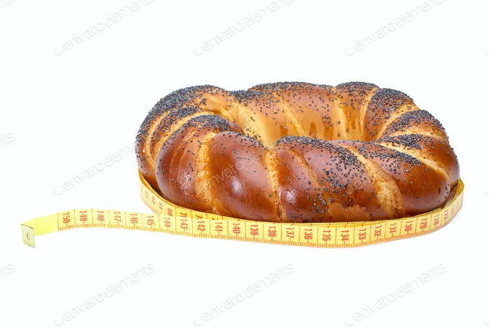 Ring shaped fancy loaf with poppyseeds and measurement tape