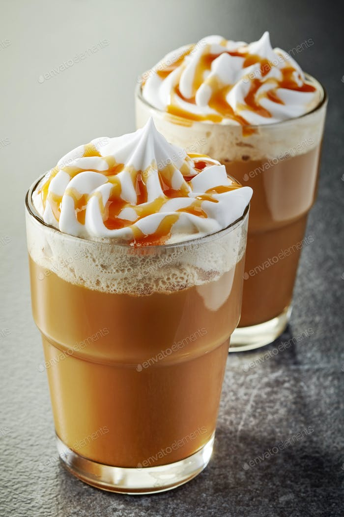 two glasses of coffee with whipped cream